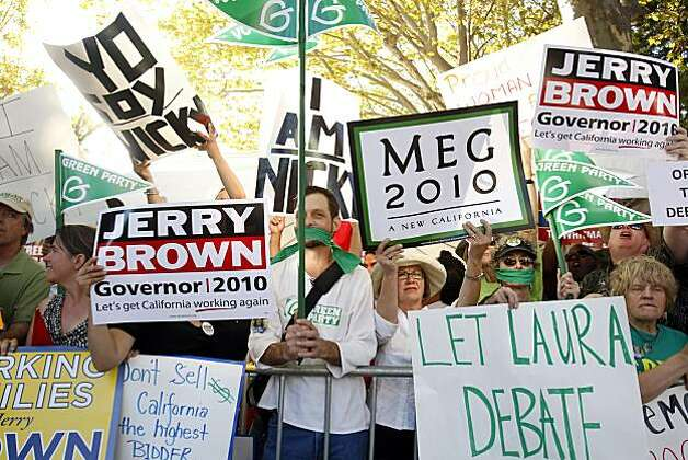 David Gesinger, a supporter of Green Party candidate Laura Wells, silently protests between raucous supporters of Meg Whitman and Jerry Brown. Wells was not allowed to participate in the gubernatorial debate at Dominican University in San Rafael on Tuesday. Photo: Carlos Avila Gonzalez, The Chronicle