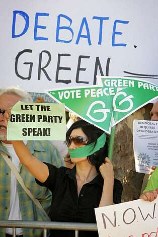 Nancy Mancias of San Rafael, the Green Party co-chair, protests for Laura Wells, the Green Party candidate who was not allowed to participate in the gubernatorial debate at Dominican University in San Rafael on Tuesday. Photo: Carlos Avila Gonzalez, The Chronicle