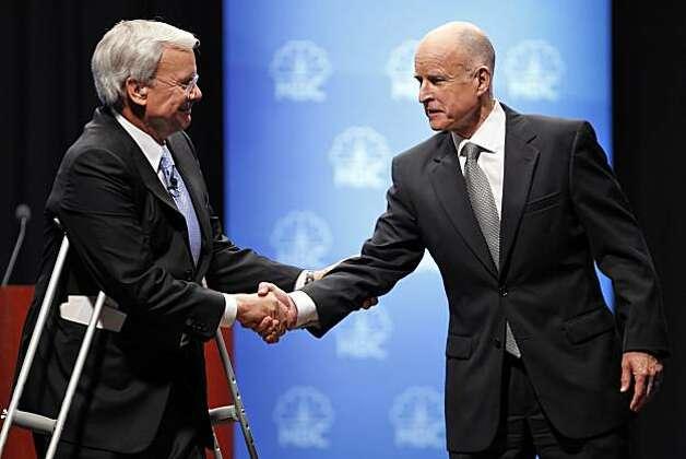 Democratic gubernatorial candidate Jerry Brown shakes hands with debate moderator Tom Brokaw before he and Meg Whitman faced off in a debate at Dominican University in San Rafael on Tuesday. Photo: Carlos Avila Gonzalez, The Chronicle