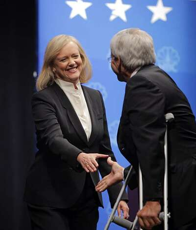 Republican gubernatorial candidate Meg Whitman, left, shakes hands with debate moderator Tom Brokaw before she and Jerry Brown faced off in a debate at Dominican University in San Rafael on Tuesday. Photo: Carlos Avila Gonzalez, The Chronicle