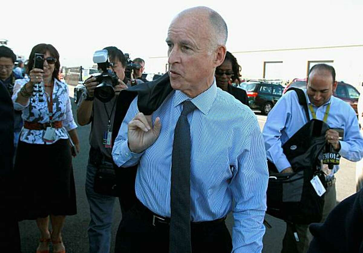 NEWARK, CA - SEPTEMBER 23: California attorney general and democratic gubernatorial candidate Jerry Brown arrives for a tour of PetersenDean Solar and Roofing on September 23, 2010 in Newark, California. Democratic gubernatorial candidate Jerry Brown toured the PetersenDean Solar and Roofing facility and held a news conference to discuss his opposition of California's Prop 23.
