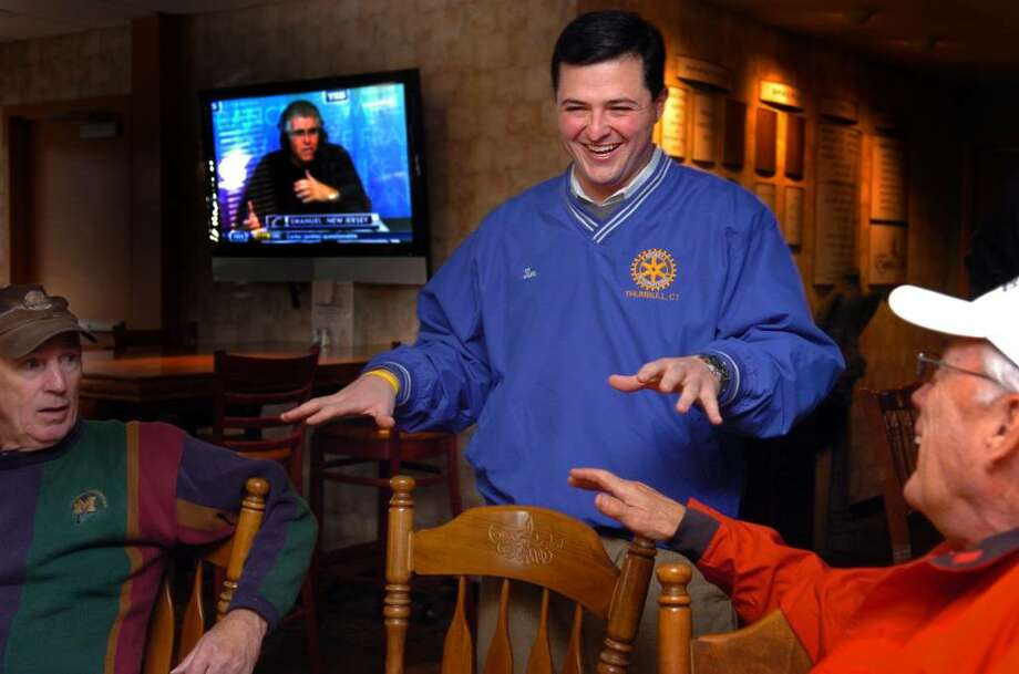 Newly-elected Trumbull first selectman Republican Tim Herbst talks with Trumbull resident Jim Carroll, left, and Jon Cady, of Milford, Wednesday at Tashua Knolls Restaurant before going out for 9 holes of golf with his father Michael and town treasurer John Ponzio. Photo: Autumn Driscoll / Connecticut Post