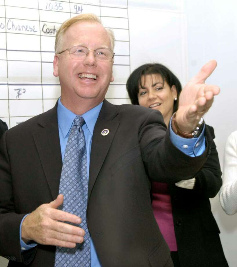 Danbury Mayor Mark Boughton, his wife Phyllis behind him, thanks supporters at Republican Headquarters election night Tuesday, November 3, 2009 Photo: Carol Kaliff / The News-Times