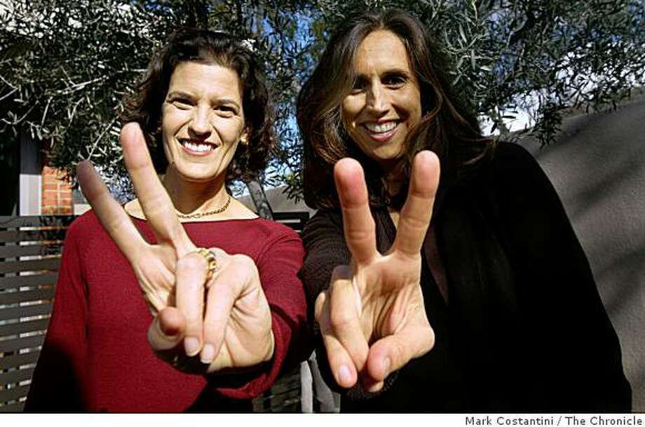 """Waving peace signs and in their words, """"declaring the end of the war between the sexes"""", Bay Area moms  Joanna Strober (left) and Sharon Meers,  the authors of the soon to be released book """"Getting to 50-50: How working couples can have it all by sharing it all""""  are photographed in Palo Alto, Calif. on Wednesday, March 4, 2009. Photo: Mark Costantini, The Chronicle"""