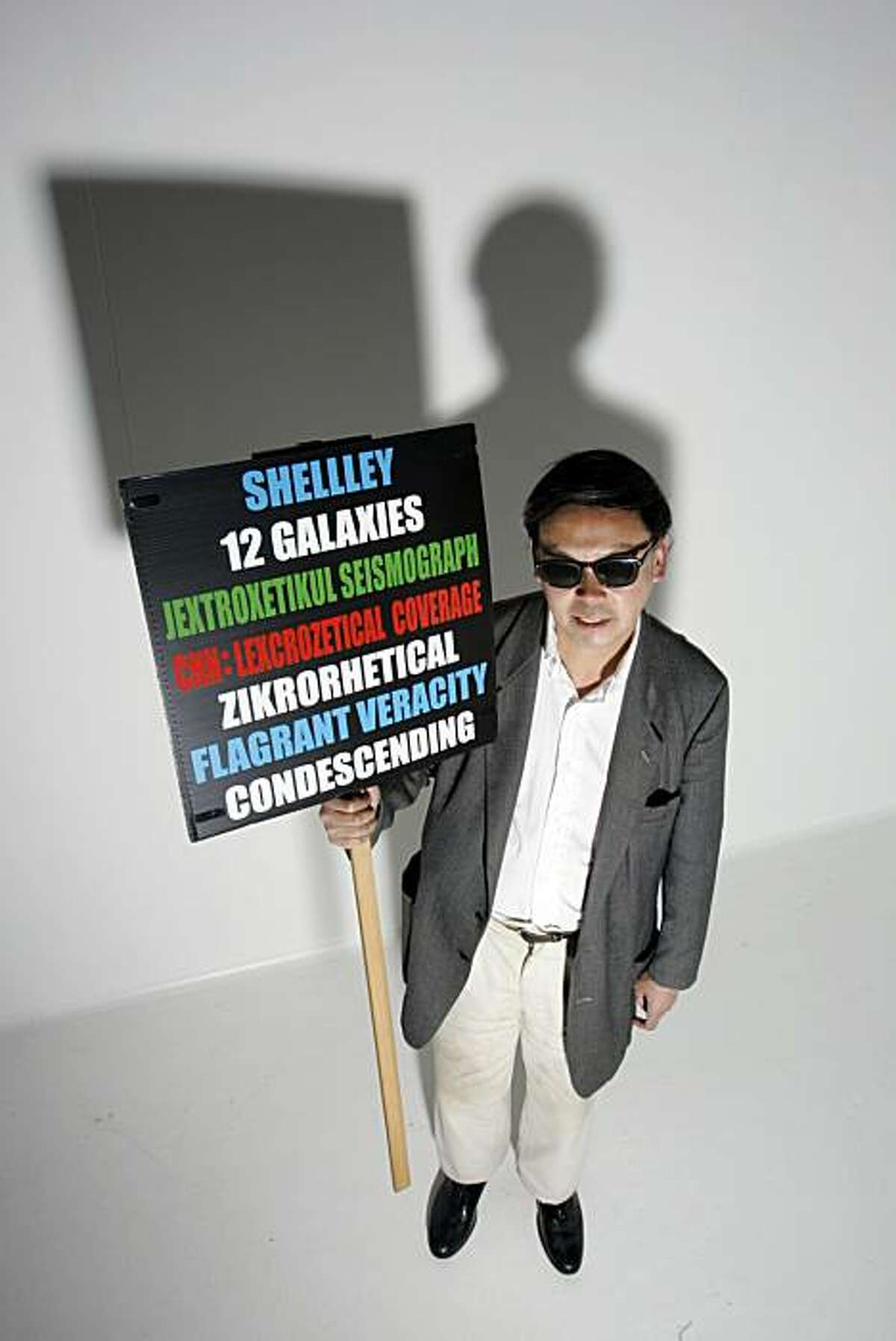 Professional protestor Frank Chu, of the legendary Zegnatronic Rocket Society. Frank, also known as the fellow who marches around the Bay Area with his multi-colored 12 Galaxies proclamation sign, was the inspiration for the name of a new live music club on Mission Street in SF called 12 Galaxies.