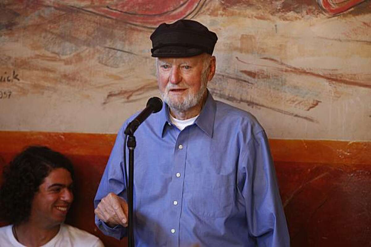 Poet Kareem James Abu-Zeid sits next to Lawrence Ferlinghetti during his reading at Cafe Triest in San Francisco. Poetry reading at Cafe Triest .Lawrence Ferlinghetti and others read .