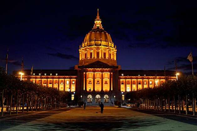 San Francisco City Hall is lit up with orange light on Monday, October 4, 2010. Photo: Carlos Avila Gonzalez, The Chronicle