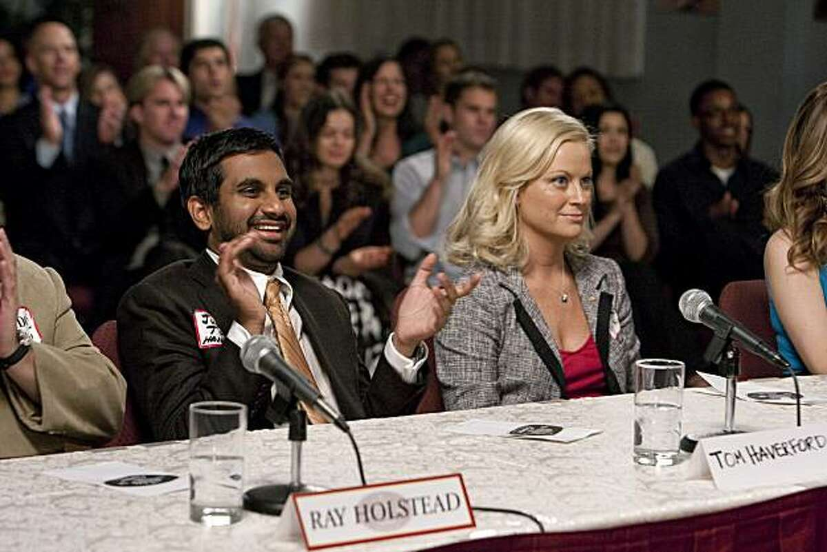 """PARKS AND RECREATION -- """"Beauty Pageant"""" Episode 203 -- Pictured: (l-r) Aziz Ansari as Tom Haverford, Amy Poehler as Leslie Knope"""