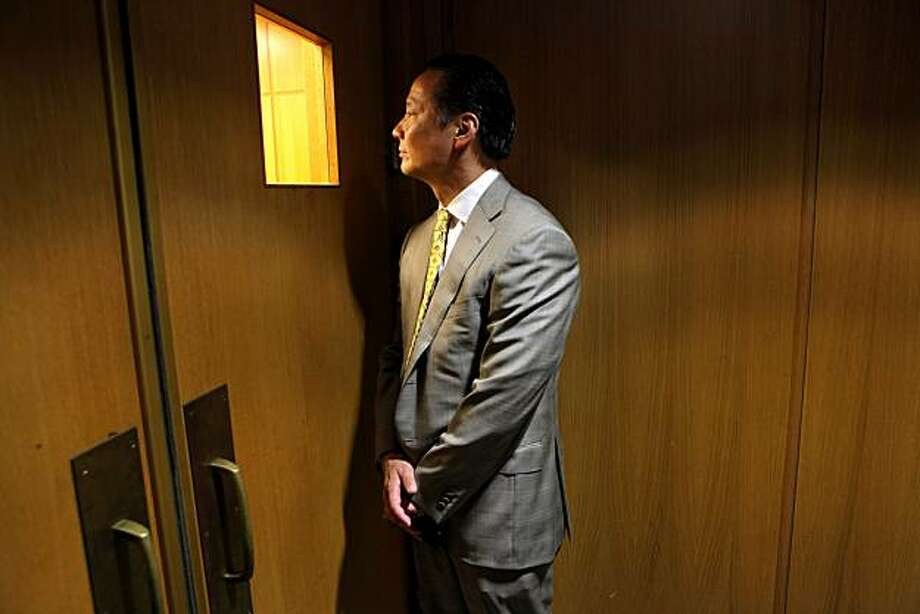 San Francisco Public Defender Jeff Adachi looks through the window into the courtroom to check on the preceding at the Hall of Justice,  Tuesday Sept. 29, 2010, in San Francisco, Calif. Photo: Lacy Atkins, The Chronicle