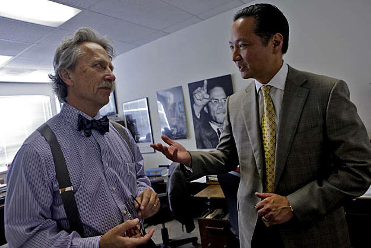 Senior felony attorney Stephen Rosen, left talks with San Francisco Public Defender Jeff Adachi in his office, Tuesday Sept. 29, 2010, in San Francisco, Calif.