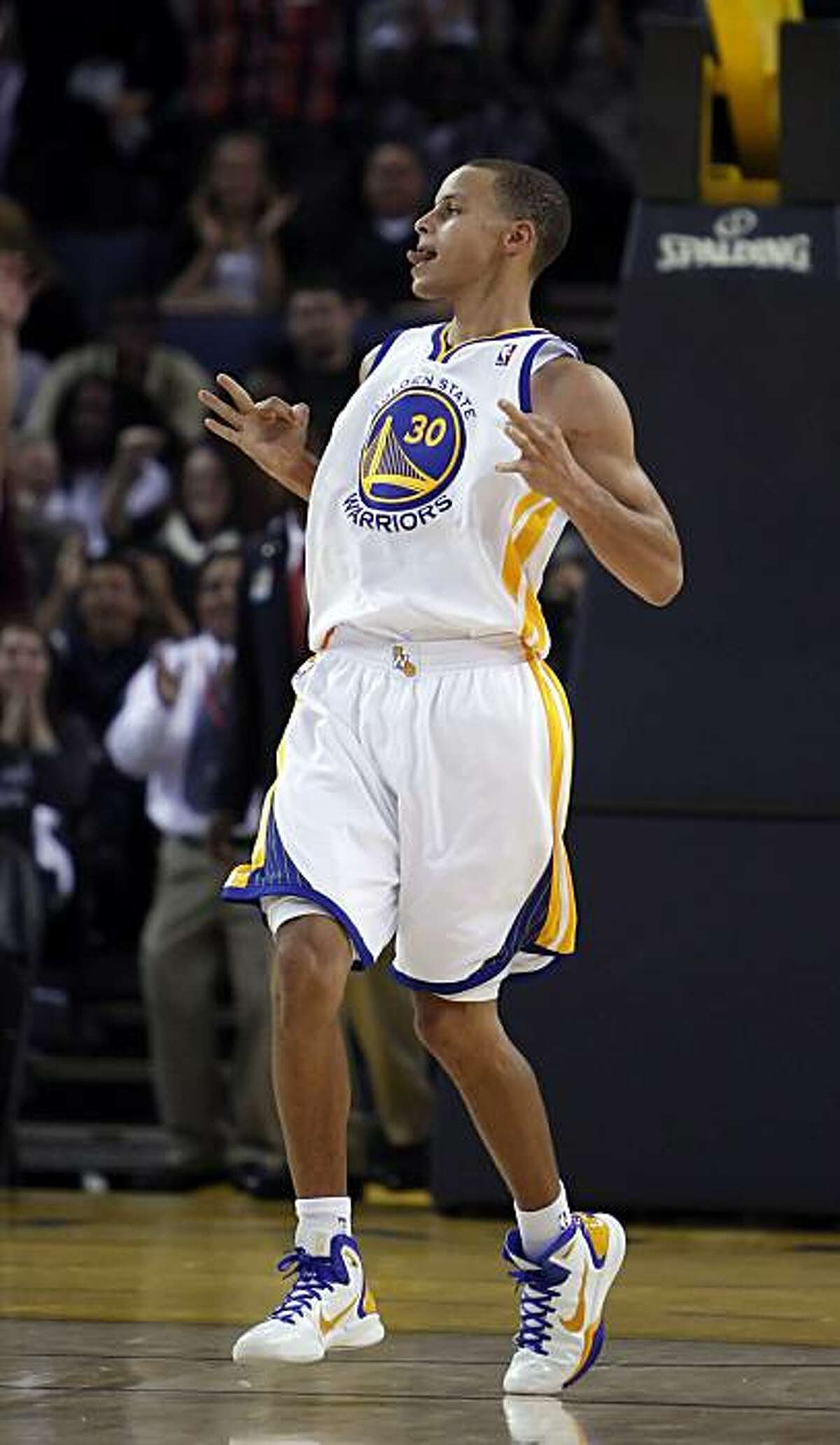 Stephen Curry of the Warriors reacts to his last second three point shot to end the third quarter. The Golden State Warriors played the Portland Trail Blazers at Oracle Arena in Oakland, Calif., on Monday, October 18, 2010, defeating the Blazers 100-78.