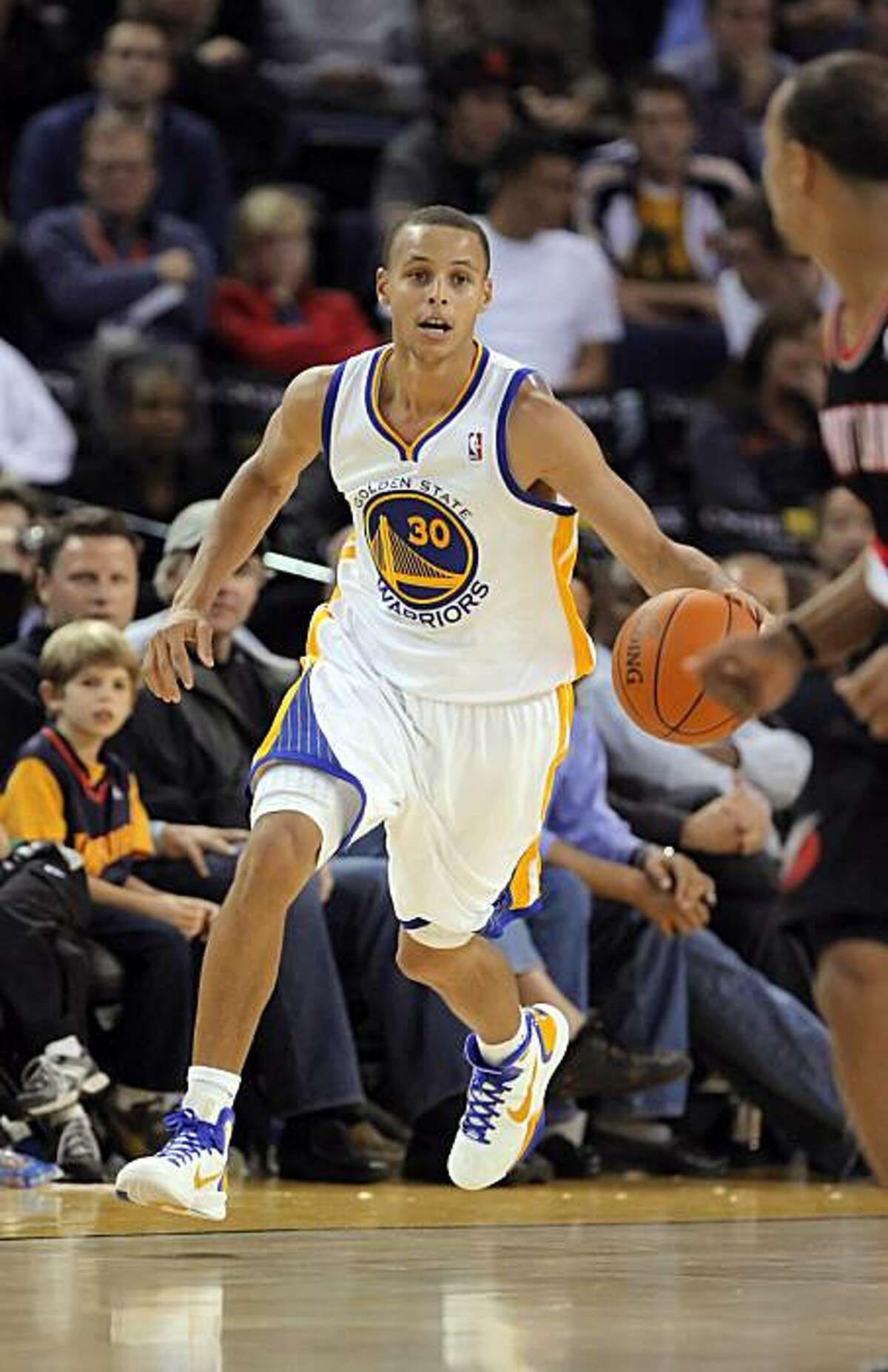 Stephen Curry brings the ball back after a steal in the second half. The Golden State Warriors played the Portland Trail Blazers at Oracle Arena in Oakland, Calif., on Monday, October 18, 2010, defeating the Blazers 100-78.