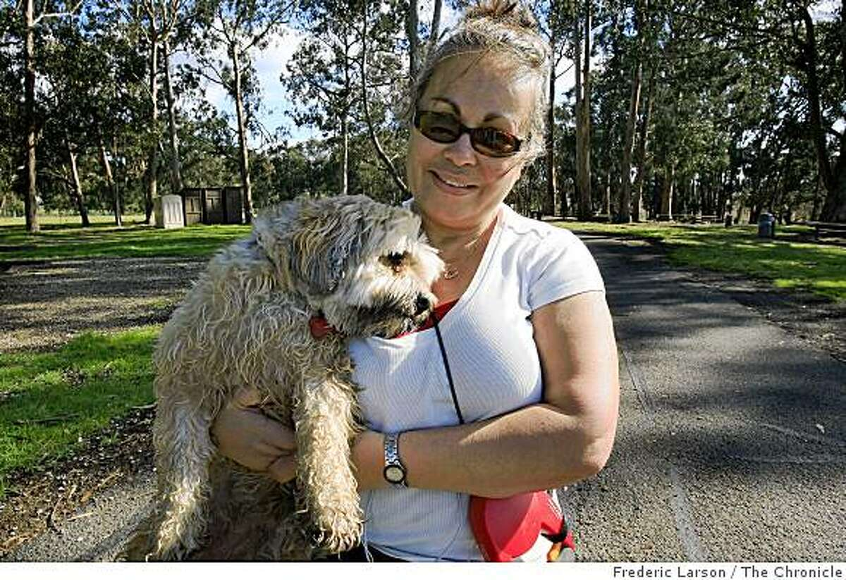 Maria Rivera of San Pablo walks her dog