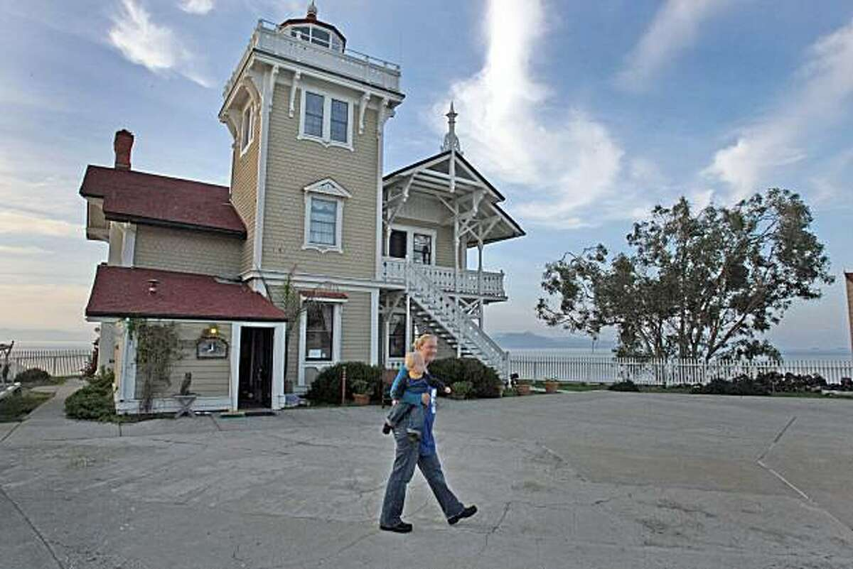 in this file photo, Katy Stewart and son Drake stroll through the main courtyard on East Brother Island off Point Richmond, Cailf., on November 28, 2008. Stewart and her husband serve as lightghouse keepers on East Brother Island.