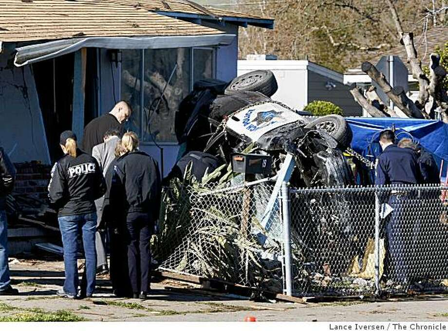An Antioch Police cruiser lies on its side after crashing into a Pittsburg, Calif., home in the 100 block of West Leland Road on Tuesday, March 10, 2009. The accident took place late Monday night during a high-speed chase of a stolen car driven by David Cole age 36 a known auto theft parolee now in custody. The unidentified officer is in critical condition. Photo: Lance Iversen, The Chronicle