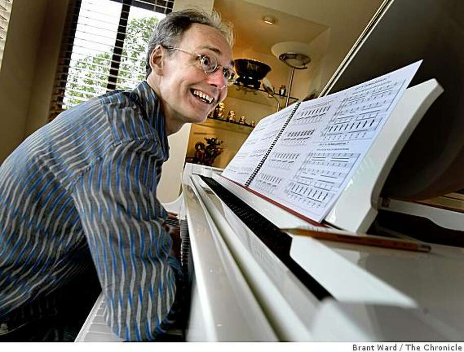 Composer Michael Harrison smiles and uses his arm to pound the keyboard during the finale of his piece. Performing in the Other Minds Festival will be Michael Harrison and the Del Sol Quartet featuring a piano and strings piece by Harrison. They practiced for the upcoming performance in San Francisco, CA Thursday February 12, 2009. Photo: Brant Ward, The Chronicle