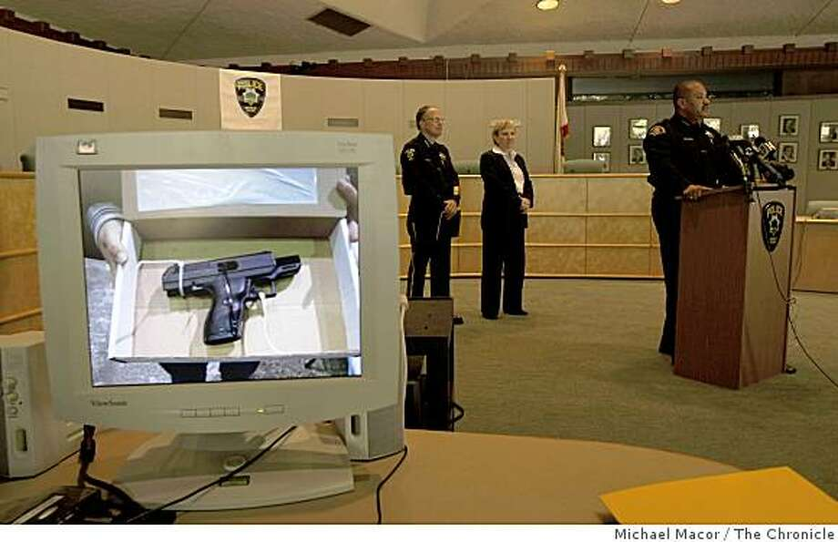East Palo Alto Police Chief Ron Davis, (at podium) dicusses the details of the Taliban gang investigation as he is joined by  Bruce Goitia, Menlo Park Police Chief,  and Charlene Thorton, Special agent in charge, San Francisco, during a press conference in Menlo Park, Calif. on Saturday Mar. 7, 2009, as images of the seized assets scroll across a computer screen. Photo: Michael Macor, The Chronicle