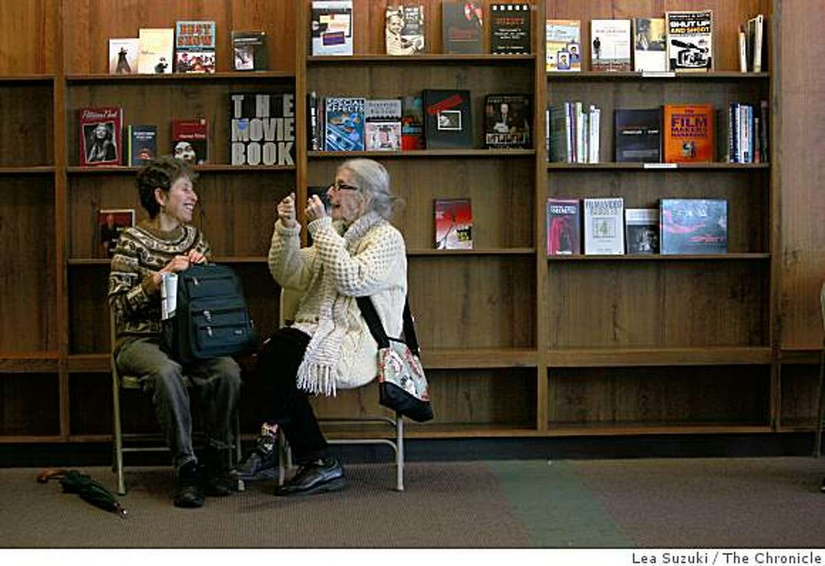 Esther (left to right) of San Francisco talks with Shirley Olsen of San Francisco after the farewll event at Stacy's Bookstore in San Francisco, Calif. on Wednesday, March 4, 2009.