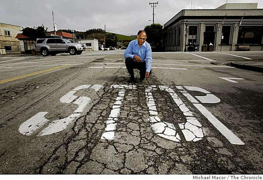 City Engineer, of Half Moon Bay, Calif., Mo Sharma on Kelly Street at Main Street with the damaged roadway near City Hall, on Tuesday Mar. 3, 2009. The City plans to use the Federal Stimulus money it will receive to resurface 5 blocks of it's Main Street that runs through the center of town. Photo: Michael Macor, The Chronicle