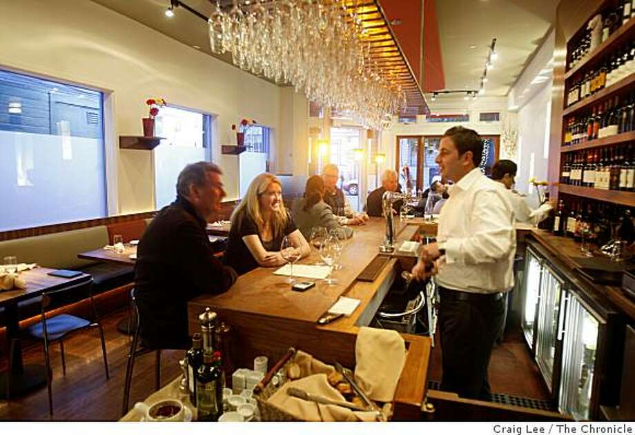 Francesco Covucci (right), owner of Vicoletto restaurant, serving Nando Di Donato (left) and Alexis Violin in San Francisco, Calif., on February 26, 2009. Photo: Craig Lee, The Chronicle