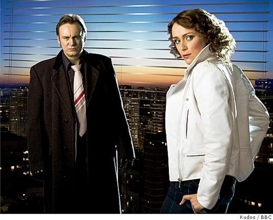 "PHILIP GLENISTER as DCI Gene Hunt and KEELEY HAWES as DI Alex Drake in ""Ashes to Ashes."" Photo: Kudos, BBC"