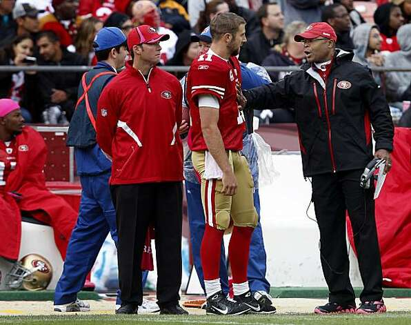 49ers head coach Mike Singletary and quarterback Alex Smith talk in the first half of their game against the Raiders on Sunday at Candlestick Park. Photo: Brant Ward, The Chronicle