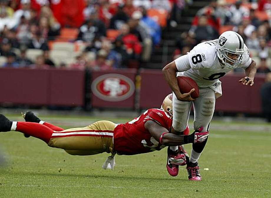 Raiders quarterback Jason Campbell gets caught running the ball in the second half against the 49ers on Sunday at Candlestick Park. Photo: Brant Ward, The Chronicle