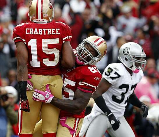 Vernon Davis helps Michael Crabtree celebrate his go-ahead touchdown against the Raiders on Sunday at Candlestick Park. Photo: Brant Ward, The Chronicle