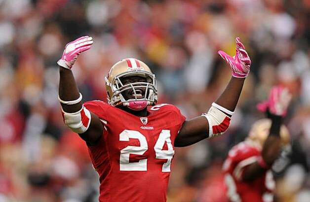 Anthony Dixon tries to keep the crowd fired up after scoring the 49ers' first touchdown against the Raiders at Candlestick Park on Sunday. Photo: Chad Ziemendorf, The Chronicle