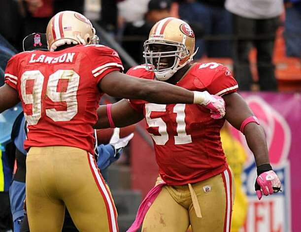 The 49ers' Takeo Spikes is congratulated Manny Lawson after intercepting a pass from Oakland quarterback Jason Campbell at Candlestick Park on Sunday. Photo: Chad Ziemendorf, The Chronicle