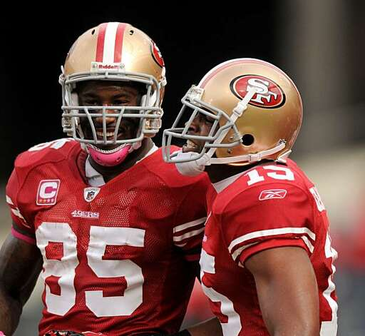 Vernon Davis (left) celebrates with Michael Crabtree after Crabtree scored the 49ers first touchdown of the day against the Oakland Raiders at Candlestick Park on Sunday. Photo: Chad Ziemendorf, The Chronicle