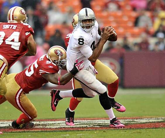 Oakland quarterback Jason Campbell does his best to scramble away from 49ers defense in the first quarter at Candlestick Park on Sunday. Photo: Chad Ziemendorf, The Chronicle