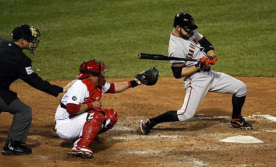 The Giants' Cody Ross is brushed back and later called out on strikes in the ninth inning of Game 2 of the NLCS on Sunday Citizens Bank Park in Philadelphia. Photo: Lance Iversen, The Chronicle