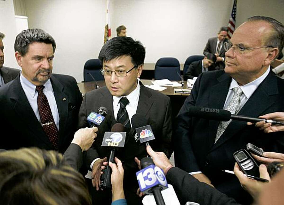 State Finance Director Mike Genest, left,, Controller John Chiang, center, and Treasurer Billl Lockyer, talk with reporters in Sacramento, Calif., Wednesday, Dec. 17, 2008.