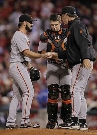 Giants pitcher Brian Wilson gets the ball from manager Bruce Bochy in the seventh inning against the Philadelphia Phillies in Game 1 of the National League Championship Series on Saturday at Citizens Bank Park in Philadelphia. Photo: Michael Macor, The Chronicle