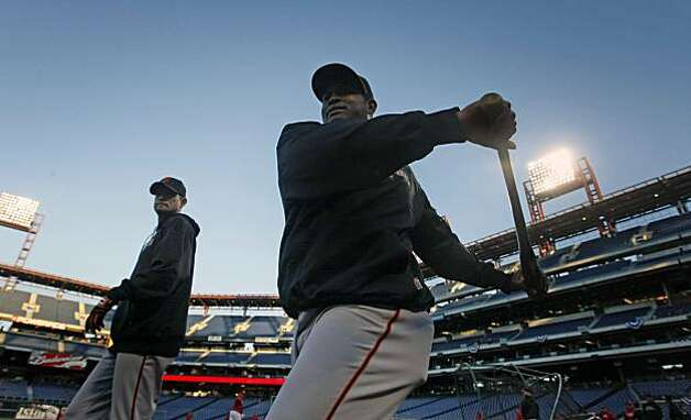 The Giants' Santiago Casilla warms up with his teammates at Citizens Bank Park in Philadelphia on Saturday prior to the start of their NLCS series with the Phillies. Photo: Lance Iversen, The Chronicle