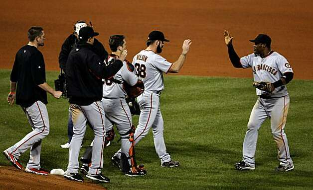 Closer Brian Wilson is greeted by Juan Uribe after the Giants' NLCS Game 1 victory at Citizens Bank Park in Philadelphia on Saturday. Photo: Lance Iversen, The Chronicle