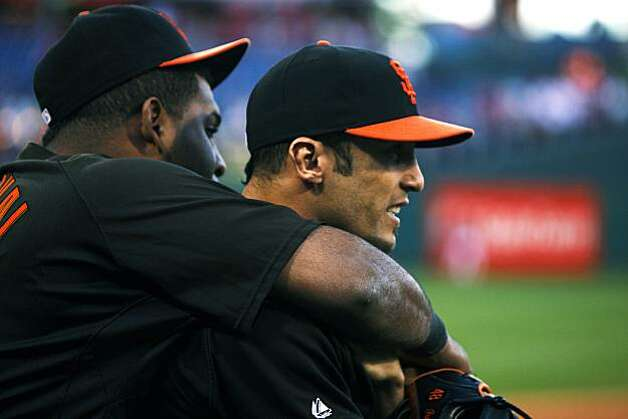 Pablo Sandoval hugs Andres Torres prior to the Giants' warm ups at Citizens Bank Park in Philadelphia on Saturday. Photo: Lance Iversen, The Chronicle