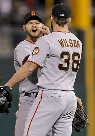 Giants Cody Ross (left) and Brian Wilson celebrate their win against the Philadelphia Phillies in Game 1 of the National League Championship Series on Saturday at Citizens Bank Park in Philadelphia. Photo: Michael Macor, The Chronicle
