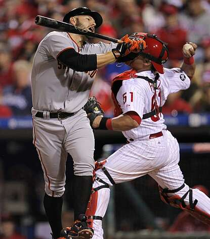 Cody Ross is brushed back by an inside pitch in the eighth inning against the Philadelphia Phillies in Game 1 of the National League Championship Series on Saturday at Citizens Bank Park in Philadelphia. Photo: Michael Macor, The Chronicle