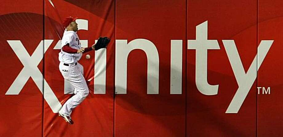 The Phillies' Raul Ibanez misjudges a ball hit by the Giants' Pat Burrell, who got a double in the sixth inning of Game 1 of the NLCS at Citizens Bank Park in Philadelphia on Saturday. Photo: Lance Iversen, The Chronicle