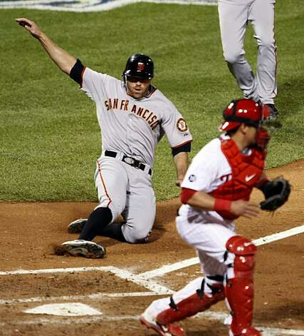 San Francisco Giants Nate Schierholtz who was running for Pat Burrell who hit a double in the 6th inning slides safely into home plate at Citizens Bank Park in Philadelphia Saturday, Oct. 16, 2010, during their NLCS series game with the Philadelphia Phillies. Photo: Lance Iversen, The Chronicle