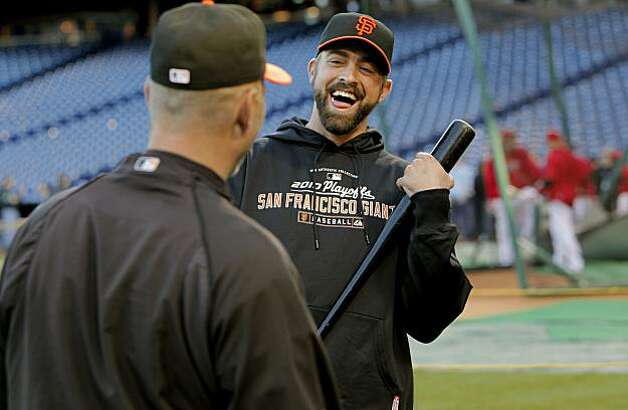 San Francisco Giants pitcher Jeremy Affeldt shares a laugh with coach Billy Hayes as the team prepares for Game 1 of the National League Championship Series against Philadelphia on Saturday at Citizens Bank Park in Philadelphia. Photo: Michael Macor, The Chronicle