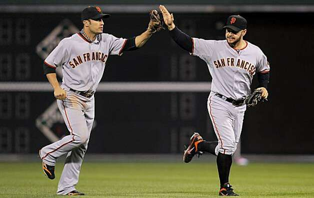 Andres Torres (left) and Cody Ross celebrate the Giants' win over the Philadelphia Phillies in Game 1 of the National League Championship Series on Saturday at Citizens Bank Park in Philadelphia. Photo: Michael Macor, The Chronicle