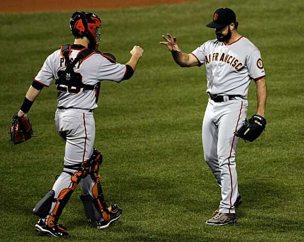 Giants catcher Buster Posey greets closer Brian Wilson after Wilson retired the Phillies to win Game 1 of the NLCS at Citizens Bank Park in Philadelphia on Saturday. Photo: Lance Iversen, The Chronicle