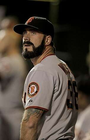 Giants pitcher Brian Wilson checks out the scoreboard after closing out the eighth inning against the Philadelphia Phillies in Game 1 of the National League Championship Series on Saturday at Citizens Bank Park in Philadelphia. Photo: Michael Macor, The Chronicle