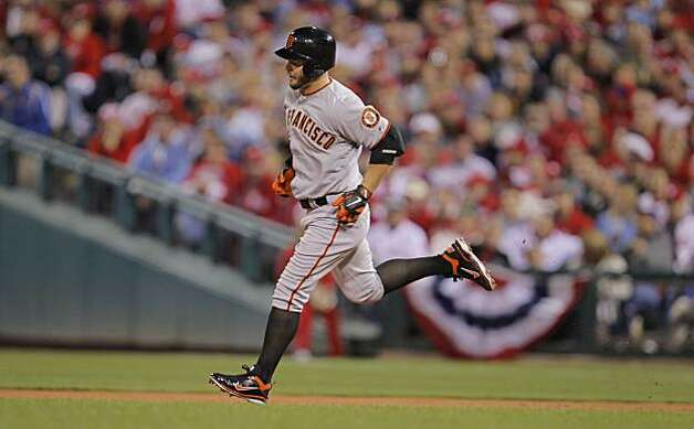 The Giants' Cody Ross rounds the bases after solo home run in the third inning of Game 1 of the National League Championship Series on Saturday at Citizens Bank Park in Philadelphia. Photo: Michael Macor, The Chronicle