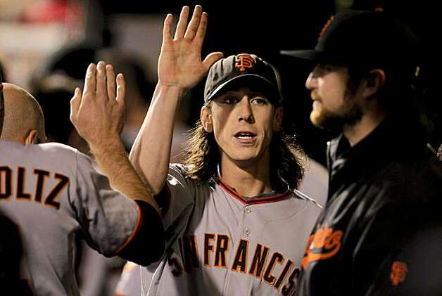 Giants pitcher Tim Lincecum gets high fives in the dugout in Game 1 of the National League Championship Series on Saturday at Citizens Bank Park in Philadelphia. Photo: Michael Macor, The Chronicle