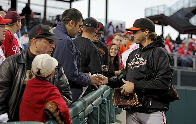San Francisco Giants pitcher Barry Zito signs autographs for fans as the team prepares for Game 1 of the National League Championship Series on Saturday at Citizens Bank Park in Philadelphia. Photo: Michael Macor, The Chronicle