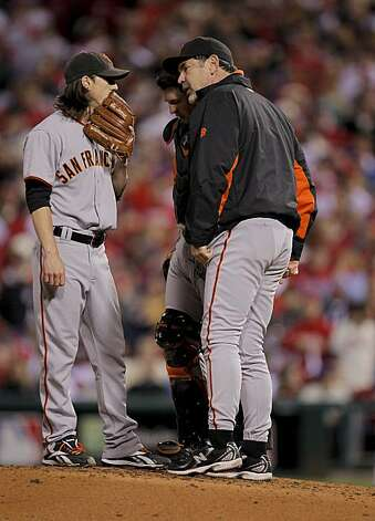 Giants manager Bruce Bochy makes a trip to the mound to visit Tim  Lincecum along with Buster Posey after giving up a run in the third inning of Game 1 of the National League Championship Series on Saturday at Citizens Bank Park in Philadelphia. Photo: Michael Macor, The Chronicle